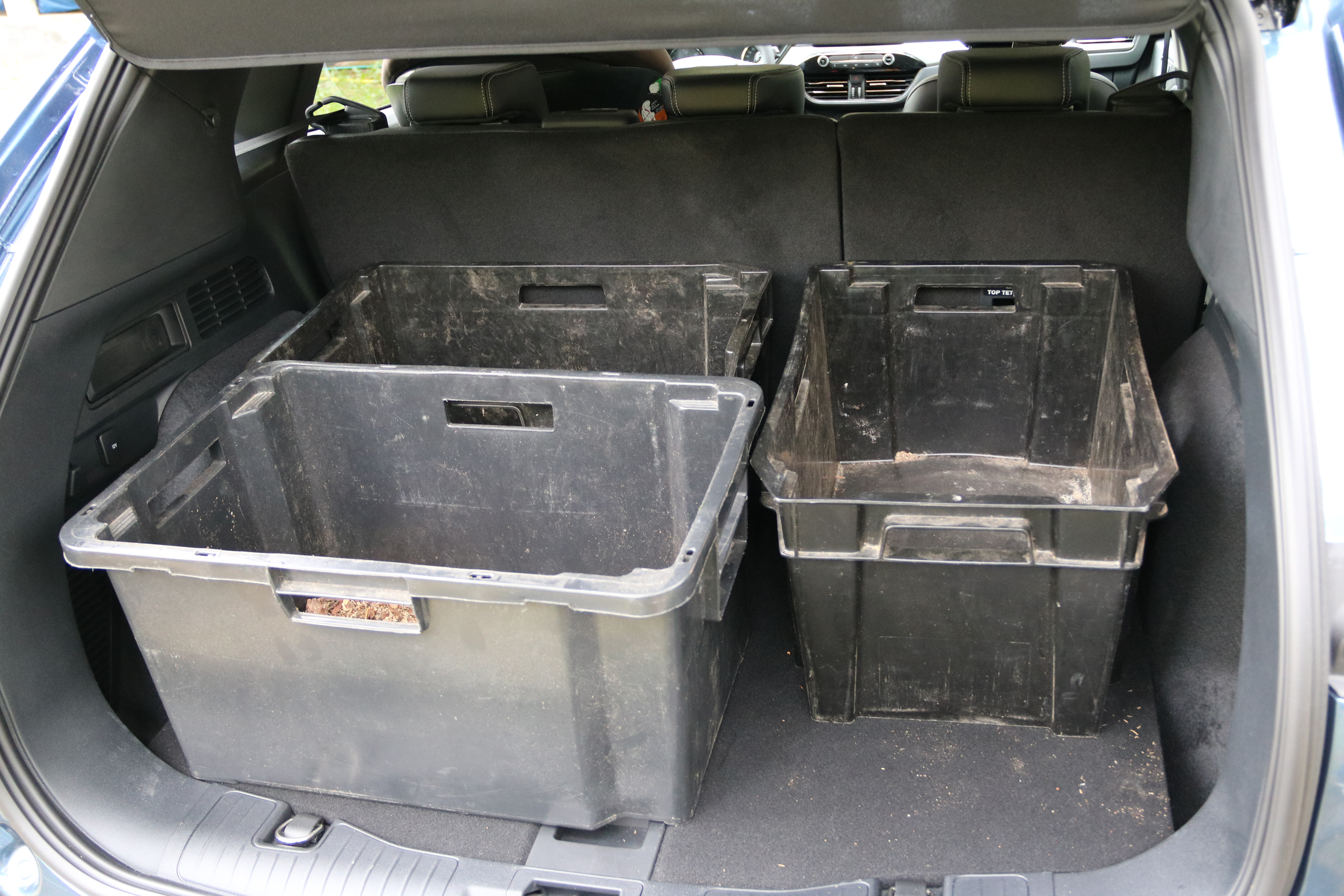 Ford Kuga PHEV trunk filled with three plastic bins