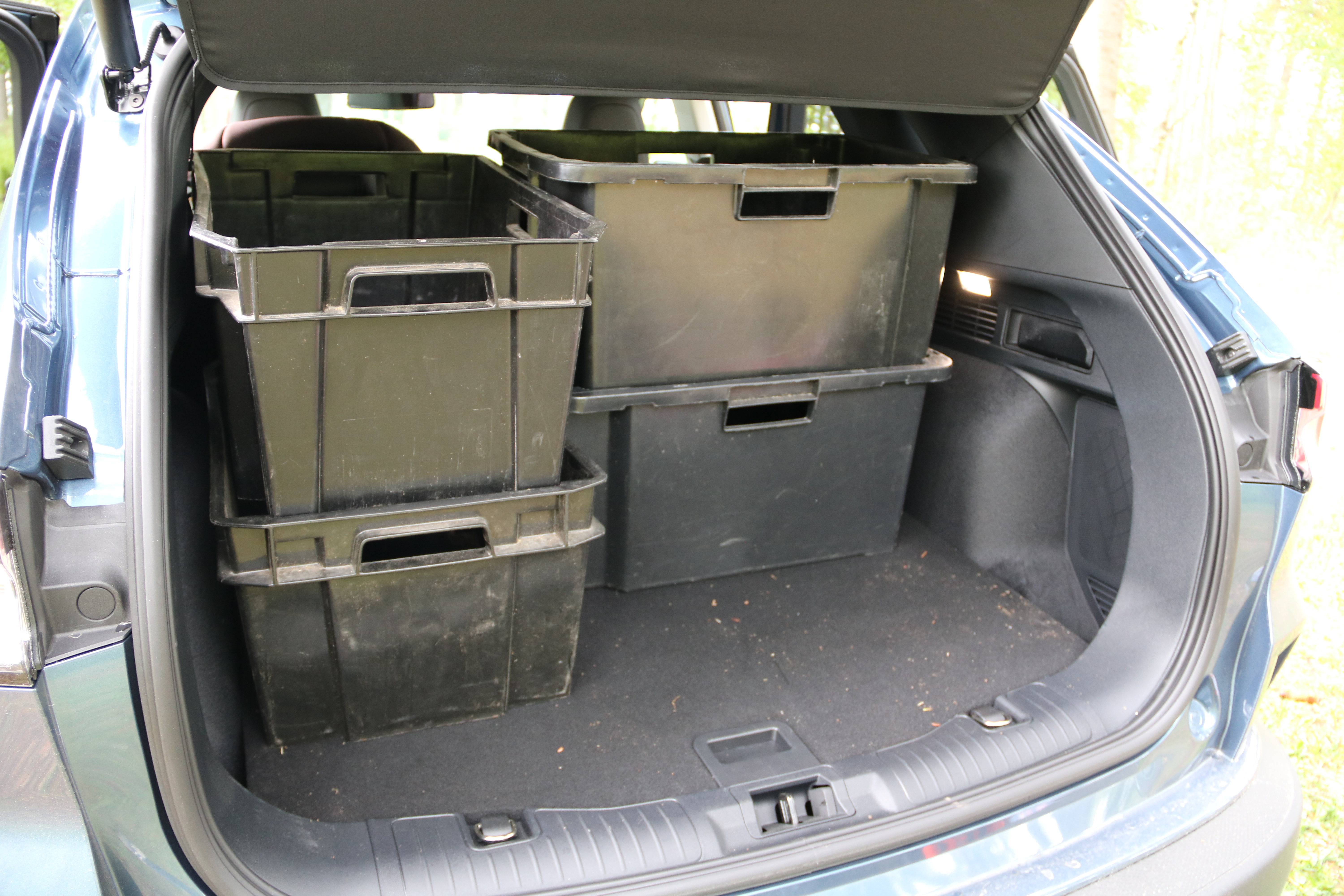 Ford Kuga PHEV trunk filled with four (five) plastic bins